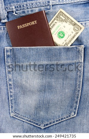 passport and cash in jeans pocket