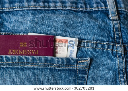 passport and Euro banknotes in jeans pocket