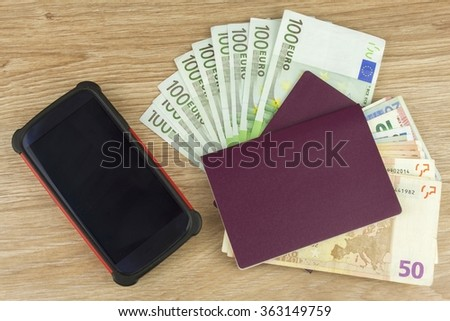 Passport and money on wooden table. Valid EURO banknotes. Illegal migration for money. Paying smugglers for crossing the border. - stock photo