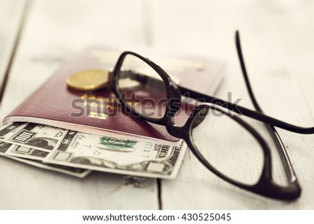 Passport and money with glasses