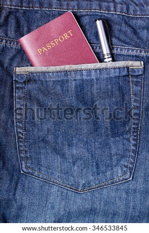 Passport and pen in blue jean pocket, traveling concept, tourism concept - stock photo