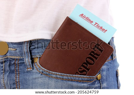 Passport and ticket in jeans pocket close-up