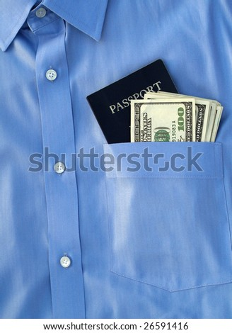 passport and us currency in the pocket of a button down shirt - stock photo