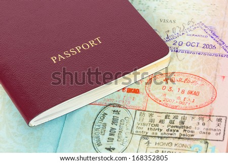 Passport and visa immigration stamps - stock photo
