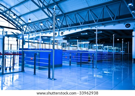 Passport control?s cabines in airport in blue - stock photo
