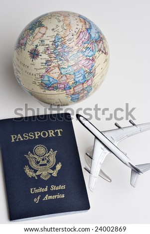 Passport, earth globe, and model plane - stock photo