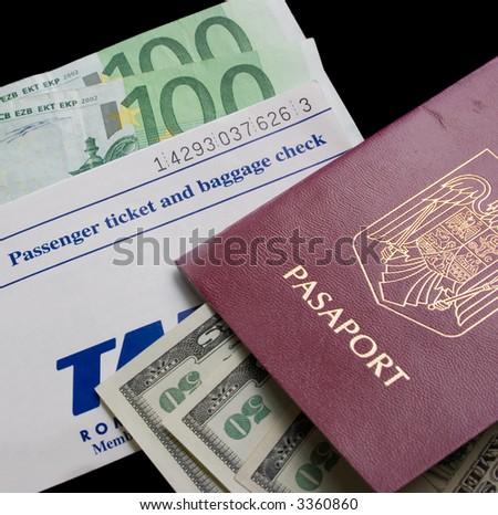 passport, flight ticket and cash - stock photo