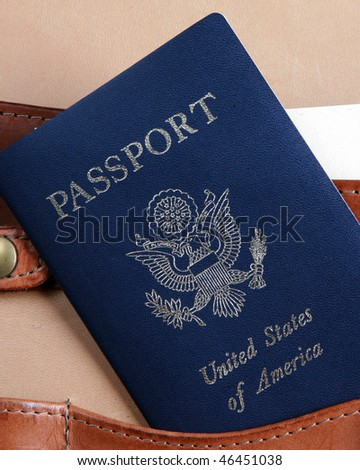 Passport in a leather briefcase - vertical image