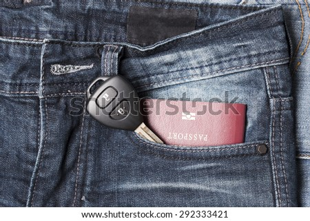 passport in jean pocket with car key - stock photo