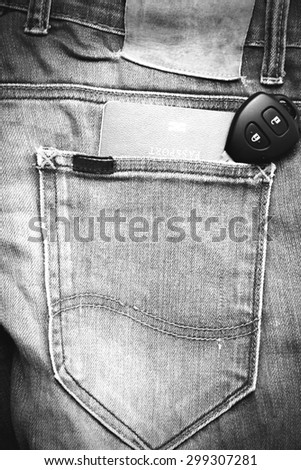 passport in jean pocket with car key black and white tone color style - stock photo
