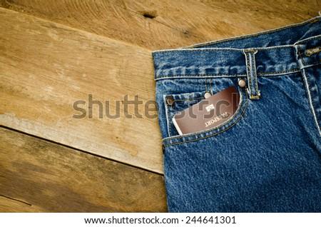 Passport in Jeans pocket - stock photo