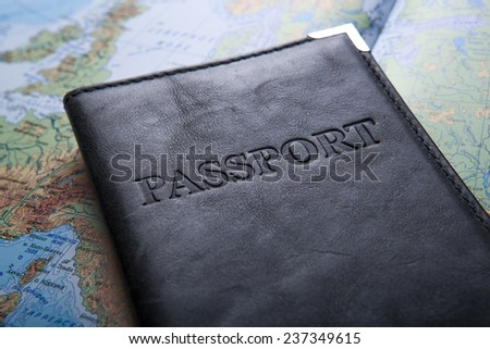passport in the bag on a map close up