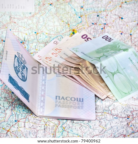 passport, money and a map on the table - stock photo