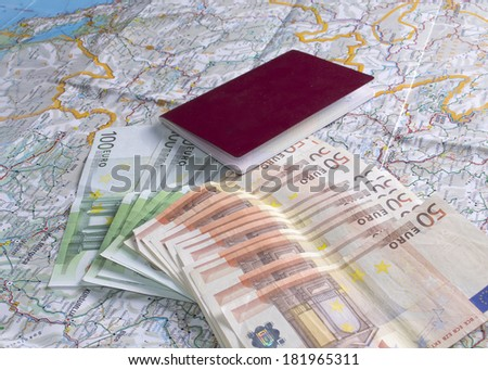 passport, money and a map on the table, close up - stock photo
