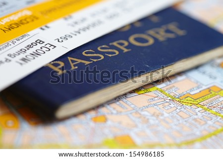 Passport on map - stock photo