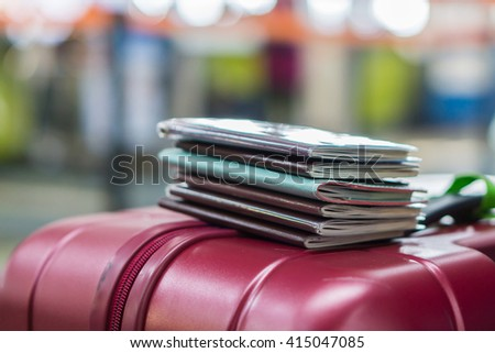 Passport on travel bag.Tourism concept, traveler's passport. Place on luggage,Traveling businessman handing passport - airport security concept,selective focus,vintage color