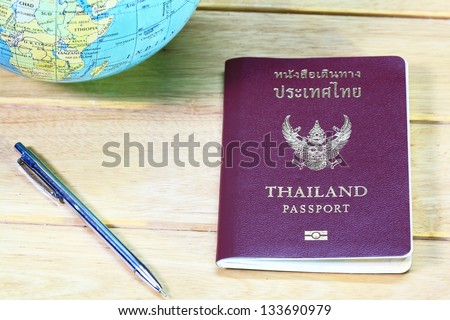 Passport on wood - stock photo