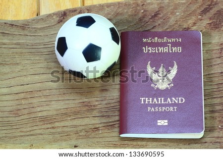 Passport on wood and football - stock photo