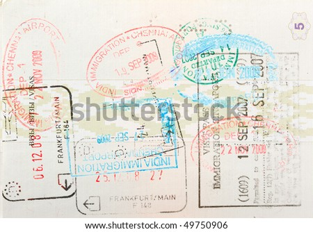 Passport page with immigration stamps close up - stock photo
