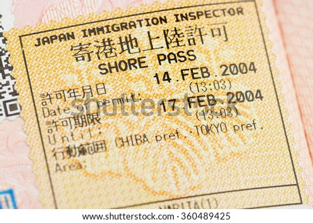 Passport page with the Japan departure immigration control stamp at the Narita airport.  - stock photo