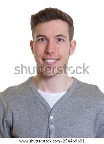 Passport picture of a laughing guy in a grey shirt - stock photo