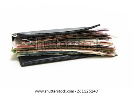 Passport pocket full of money on background - stock photo