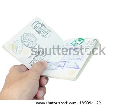 Passport stamp and hand on white background - stock photo