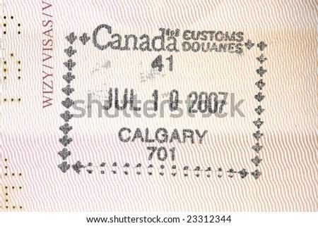 Passport stamp from Calgary, Canada in a Polish passport - stock photo