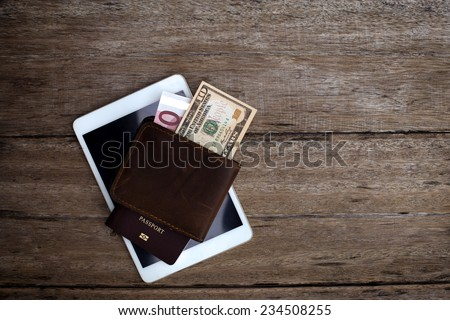Passport with a note on a wooden table. - stock photo