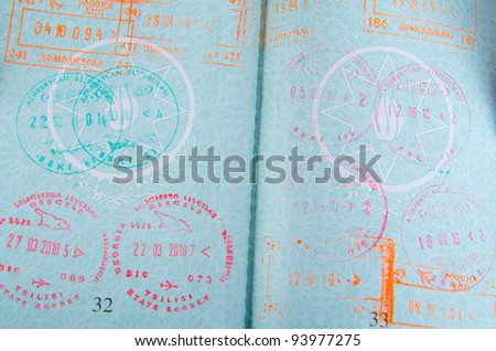 Passport with airport stamps - stock photo