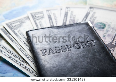 passport with dollar bills