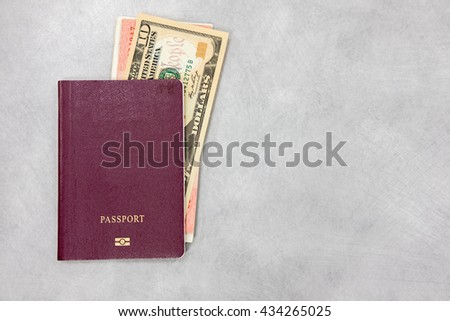 Passport with money notes and 10 dollar bill 10 US dollar money notes on table - copyspace - stock photo