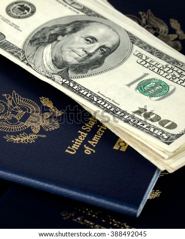 passports and us dollars, close up, no id numbers - stock photo