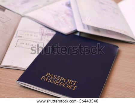passports and visas - stock photo