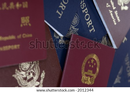 Passports lay on a table ready for the next adventure - stock photo