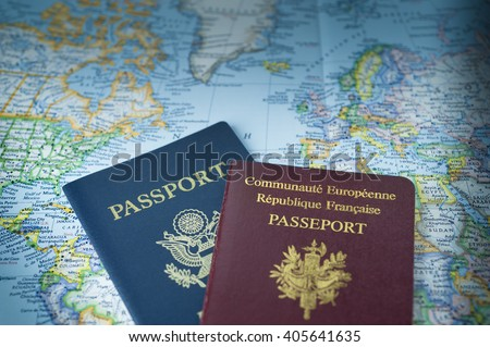 Passports on map of USA and Europe - stock photo