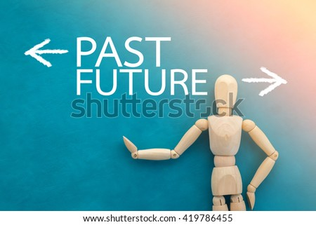 past and future dicision with wooden figure on blue background.jpg - stock photo