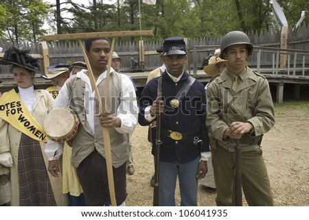 Past and present African American soldiers posing as part of the 400th anniversary of the Jamestown Colony, Virginia, at the James Fort, Jamestown Settlement, May 4, 2007 - stock photo
