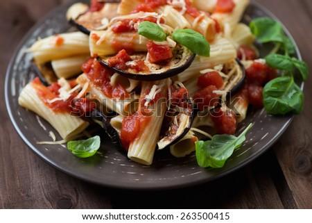 Pasta alla Norma, italian dish with eggplant and tomato - stock photo