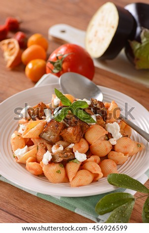 pasta alla norma - traditional Sicilian recipe with cottage cheese, eggplant and capers