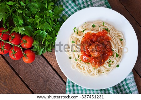 Pasta and meatballs with tomato sauce. Top view - stock photo