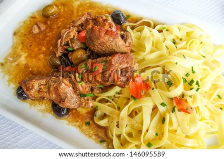pasta and pork on the table