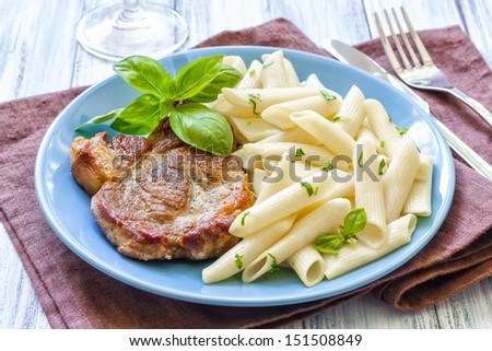 Pasta and steak - stock photo