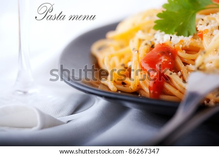 Pasta and wine shot suitable for restaurant menu - stock photo