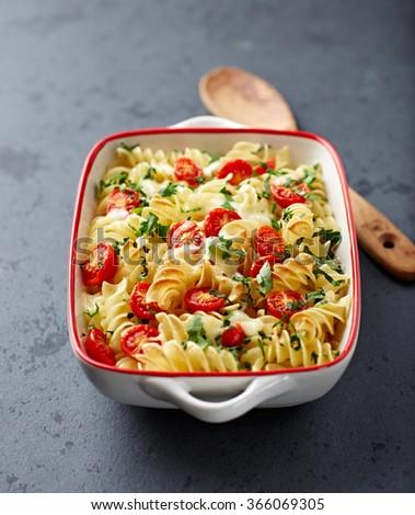 Pasta bake with mozzarella and cherry tomatoes - stock photo
