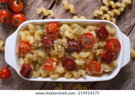 pasta baked with cherry tomatoes and sausages close-up view from above. horizontal  - stock photo