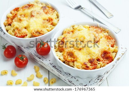 Pasta baked with tomato and cheese in a ceramic pot - stock photo