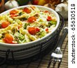 pasta baked with turkey and Roman cauliflower - stock photo