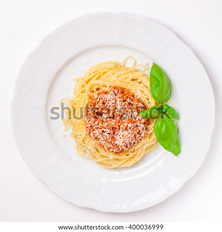 pasta bolognese on a white plate - stock photo