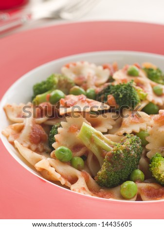 Pasta Bows with Tomato Sauce Broccoli and Peas